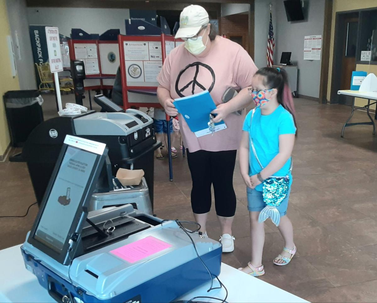 Mom and daughter voting