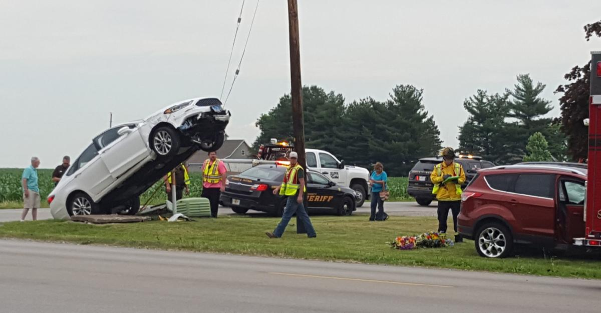 auto runs up guy wire due to accident local