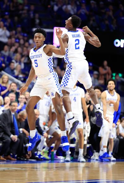 Kentucky's Immanuel Quickley (5) and Ashton Hagans (2) celebrate during a game against Vanderbilt at Rupp Arena in Lexington, Ky., on January 12, 2019. (Andy Lyons/Getty Images/TNS) **FOR USE WITH THIS STORY ONLY**