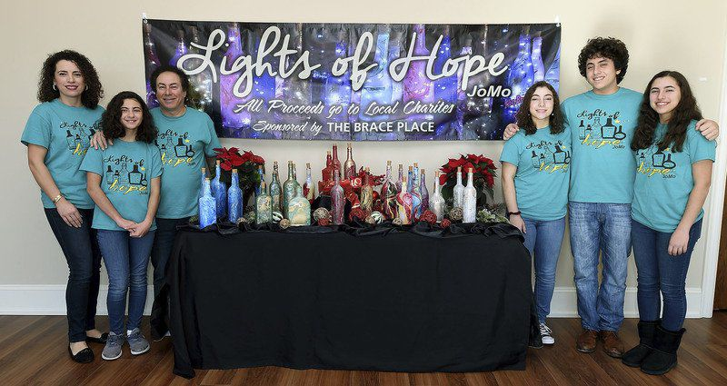 Joplin family selling lighted bottles for local charities