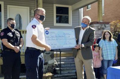 Fire survivors thank responders, security dispatcher in reunion