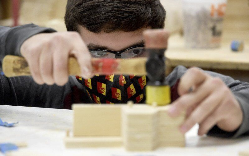 PSU elves — er, students — build toys for Christmas campaign
