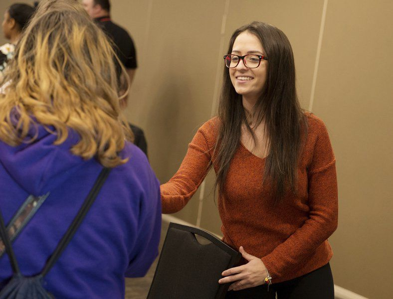 PSU students help teach high schoolers proper professional etiquette
