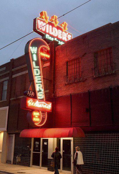 Restored Wilder's neon sign glows over Main Street again