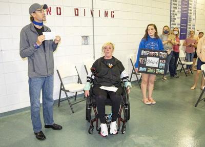 Carthage swim team earns $10,000 for injured coach