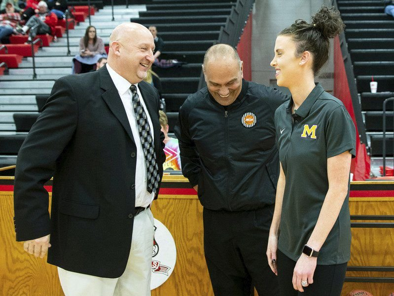 Husband, wife face off as opposing coaches