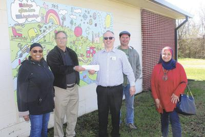 Joplin Interfaith Coalition members donate $4,000 to help erase students' lunch debt