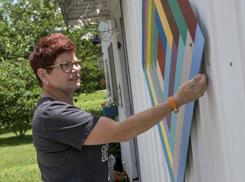 Area resident uses rural structures as backdrops for folk art