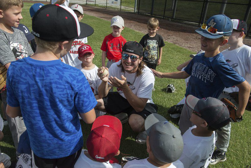 Outlaws give instruction during youth camp