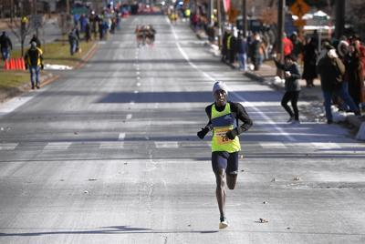 Cheserek sets record in Manchester Road Race romp