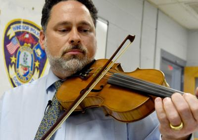 It just feels right again': Stolen violin returned to owner