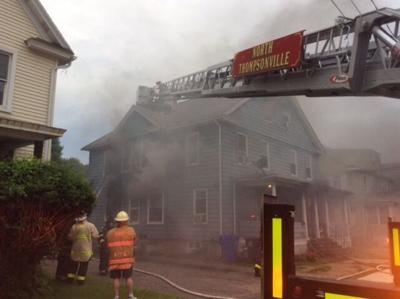 Fire damages multi-family home in Enfield