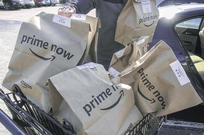 Amazon adds same-day and Whole Foods delivery | Business