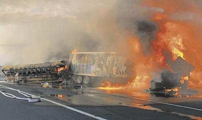 2 killed in fiery crash between school bus, 2 tractor