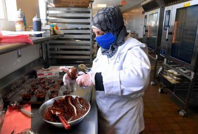 Syrian refugee Hala Ghali at UNH kitchen