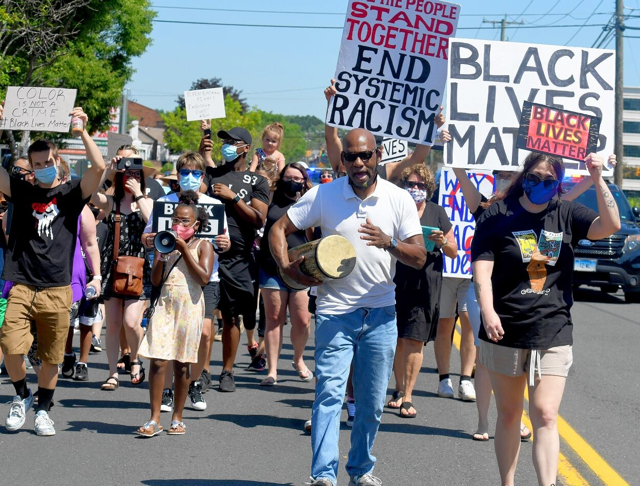 Lewis leads march