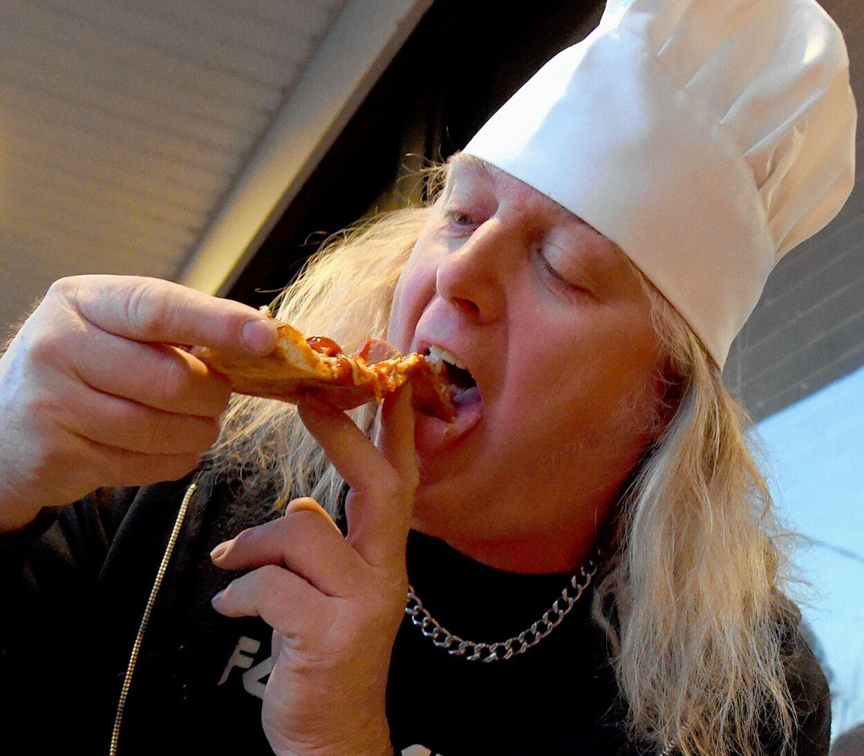 Al Thibodeau tries a slice of his pizza