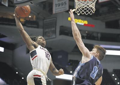 Adams scores 11 in UConn win