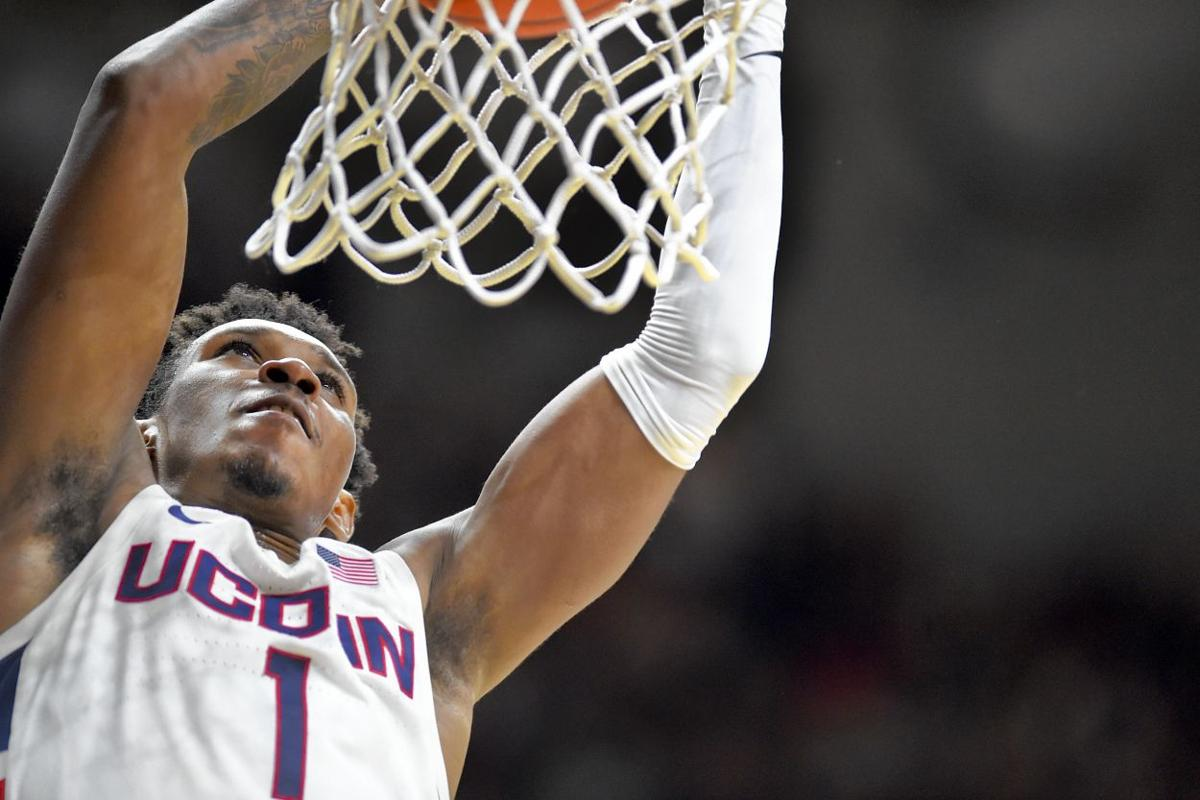 Vital dunk fires up UConn, crowd