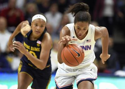 Walker wows 'em in UConn rout of ND