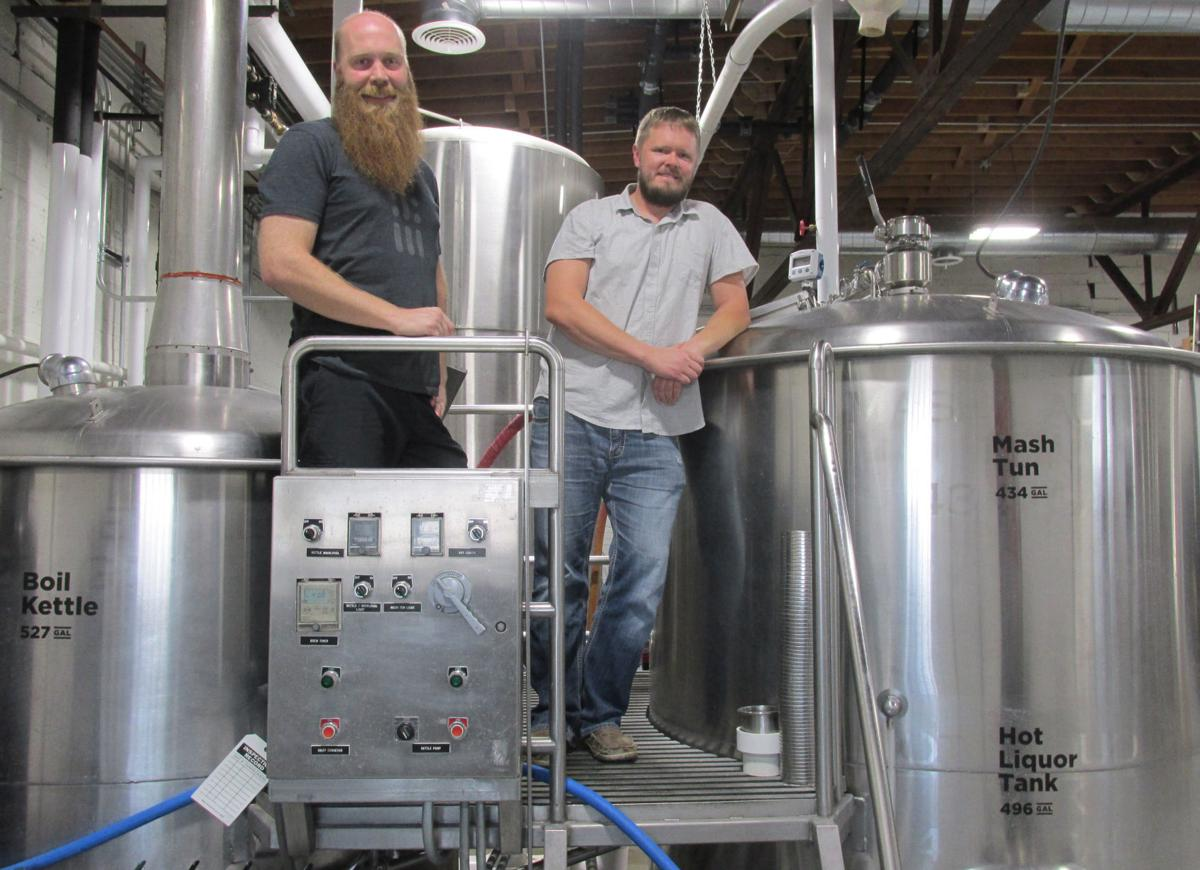 Matt Gohring (left) and Adam Holmberg check Code Beer's boil kettle and mash tun