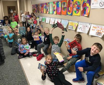 Messiah Lutheran K-Kids Club members with books they donated