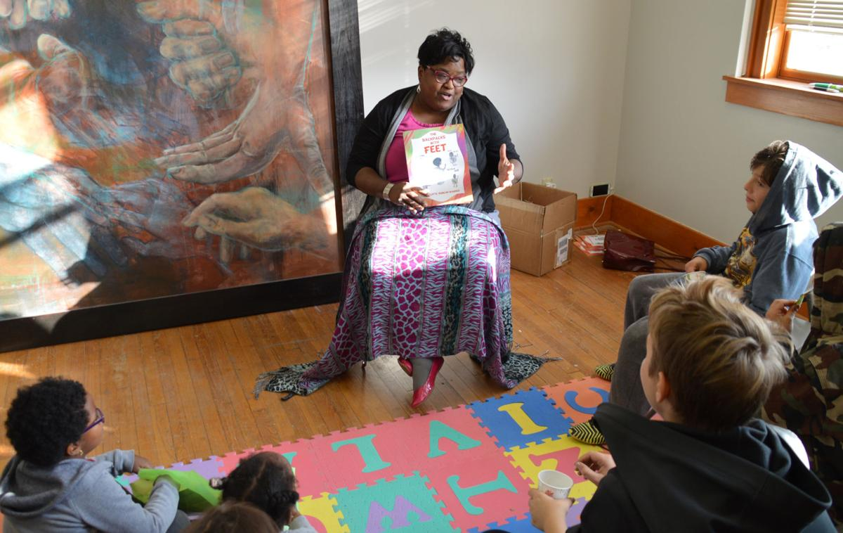 Author Charlotte Duncan-Wagner leads a story time
