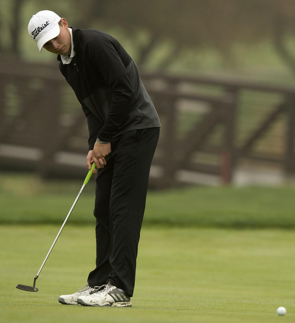 Josh Bartels putts in HAC golf championship at Holmes