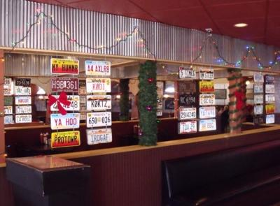 Vintage license plate display at Parker's Smokehouse