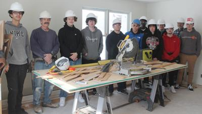 Construction students and instructors in student-built house