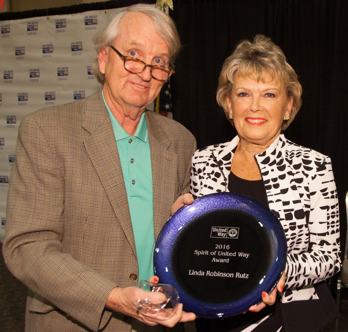 Nick Cusick presents Linda Robinson Rutz with Spirit of United Way award