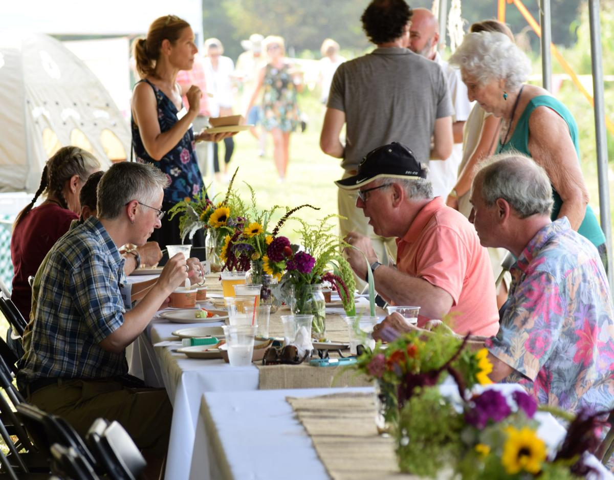Guests sample farm-to-table gourmet dishes