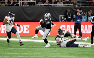 Oakland Raiders running back Josh Jacobs (28) breaks free from the Chicago Bears defense in the first quarter against the Oakland Raiders on October 6, 2019, at Tottenham Hotspur Stadium in London.