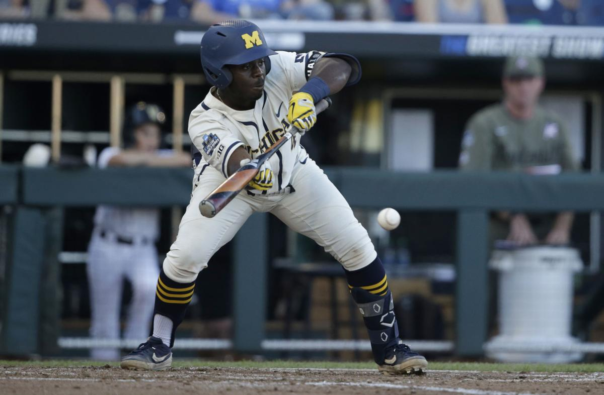 Photos: Michigan knocks off Vanderbilt in Game 1 of College