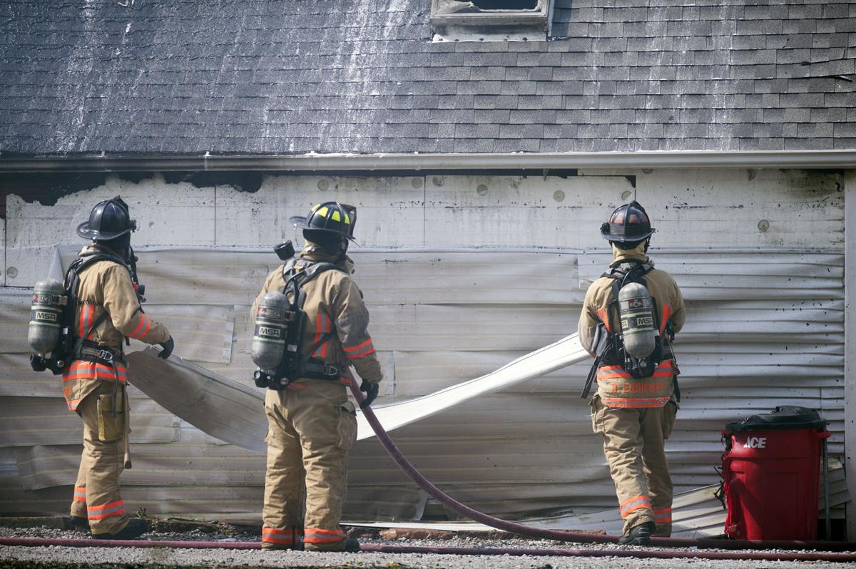 fire in backyard storage building destroys garage damages two