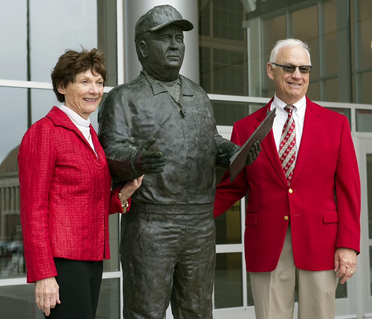 Pat and Mike Devaney pose with the statue of their father Bob Devaney  outside the East Stadium after he was inducted into the University of  Nebraska ... 4de2ba978
