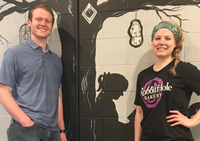 Beau Ballard and Amanda Fuchser by Alice in Wonderland mural