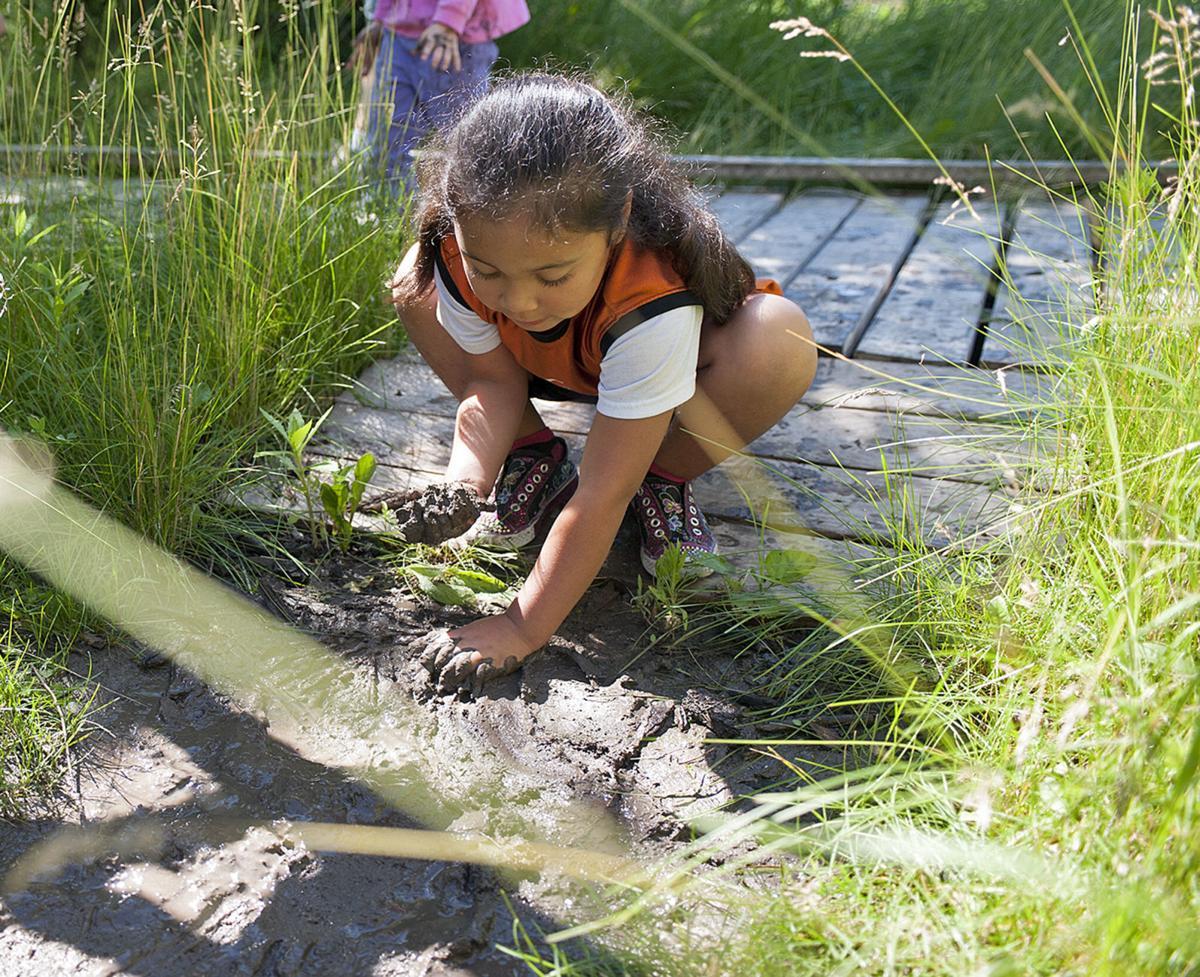 Kids learn by having fun in the mud