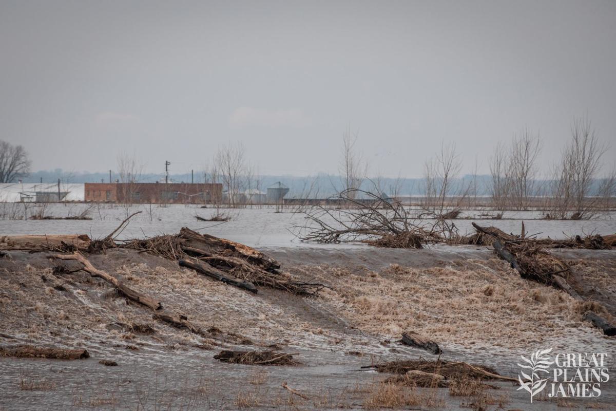 Water flowing over levee L575 across the river from Nebraska City in Percival, Iowa