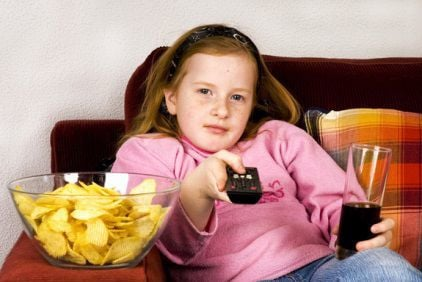 Girl, snacking, watching TV