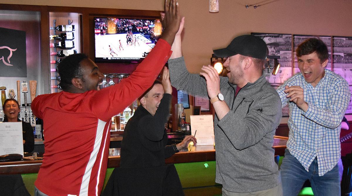 Celebrating a raffle win