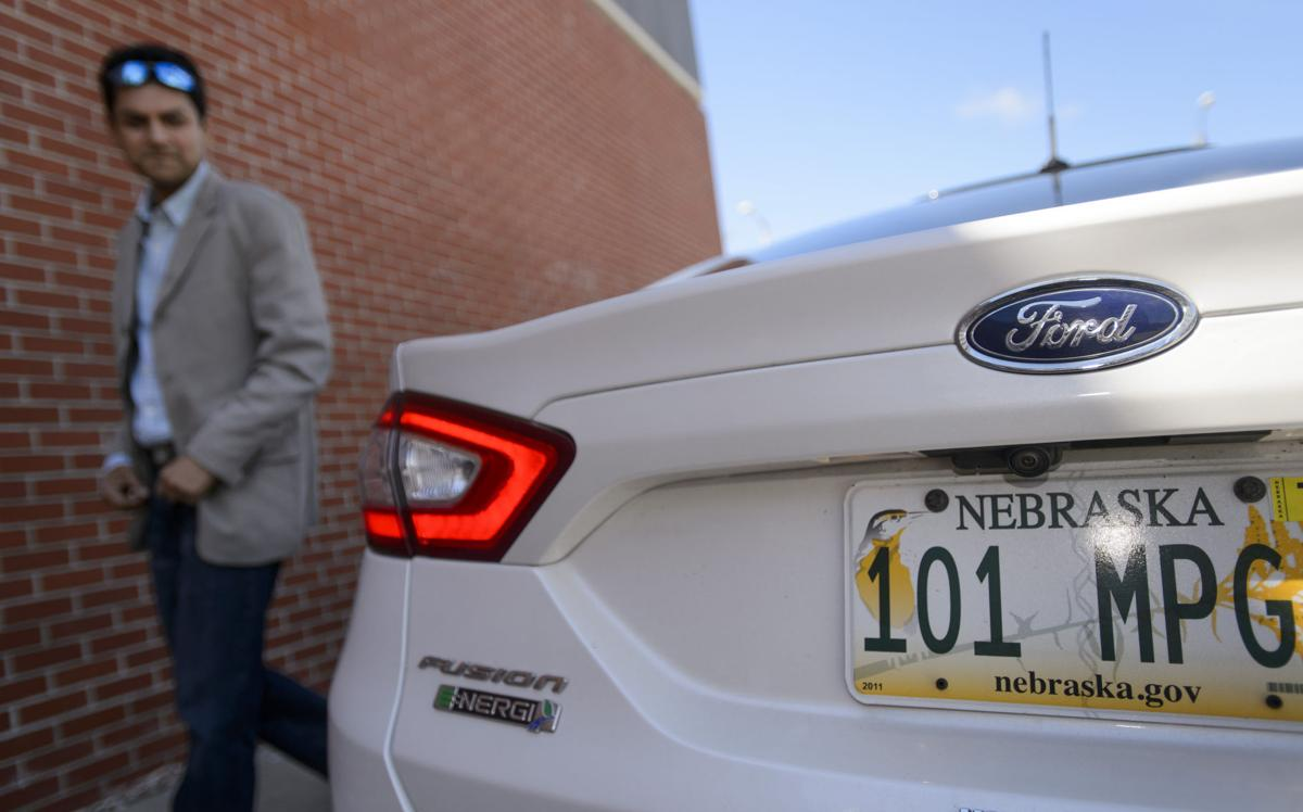Harish Singh Looks Toward The License Plate On His Ford Fusion Plug In Hybrid Has Far Surped Goal Of 100 Mpg By Obtaining A Lifetime Average