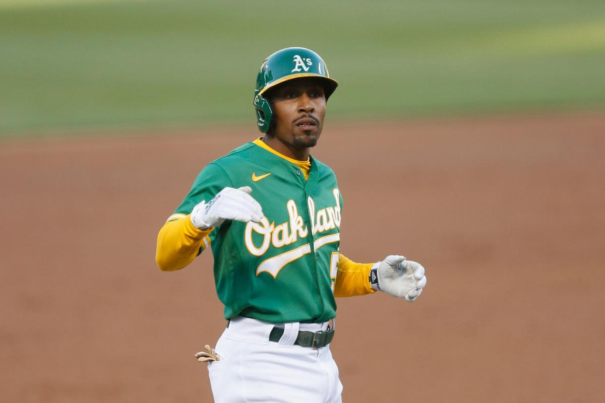 Tony Kemp of the Oakland Athletics reacts after hitting an RBI double before advancing to third base on a fielding error in the bottom of the third inning against the Los Angeles Angels at RingCentral Coliseum on Monday, June 14, 2021 in Oakland, California.