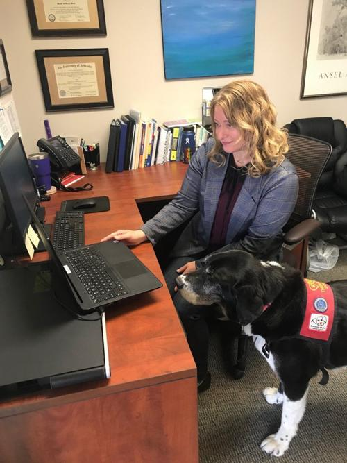Jackie Prater and George the therapy dog provide telehealth