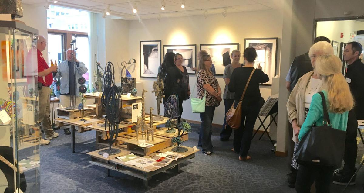 Guests visit with artists at Chapin Studios and Gallery