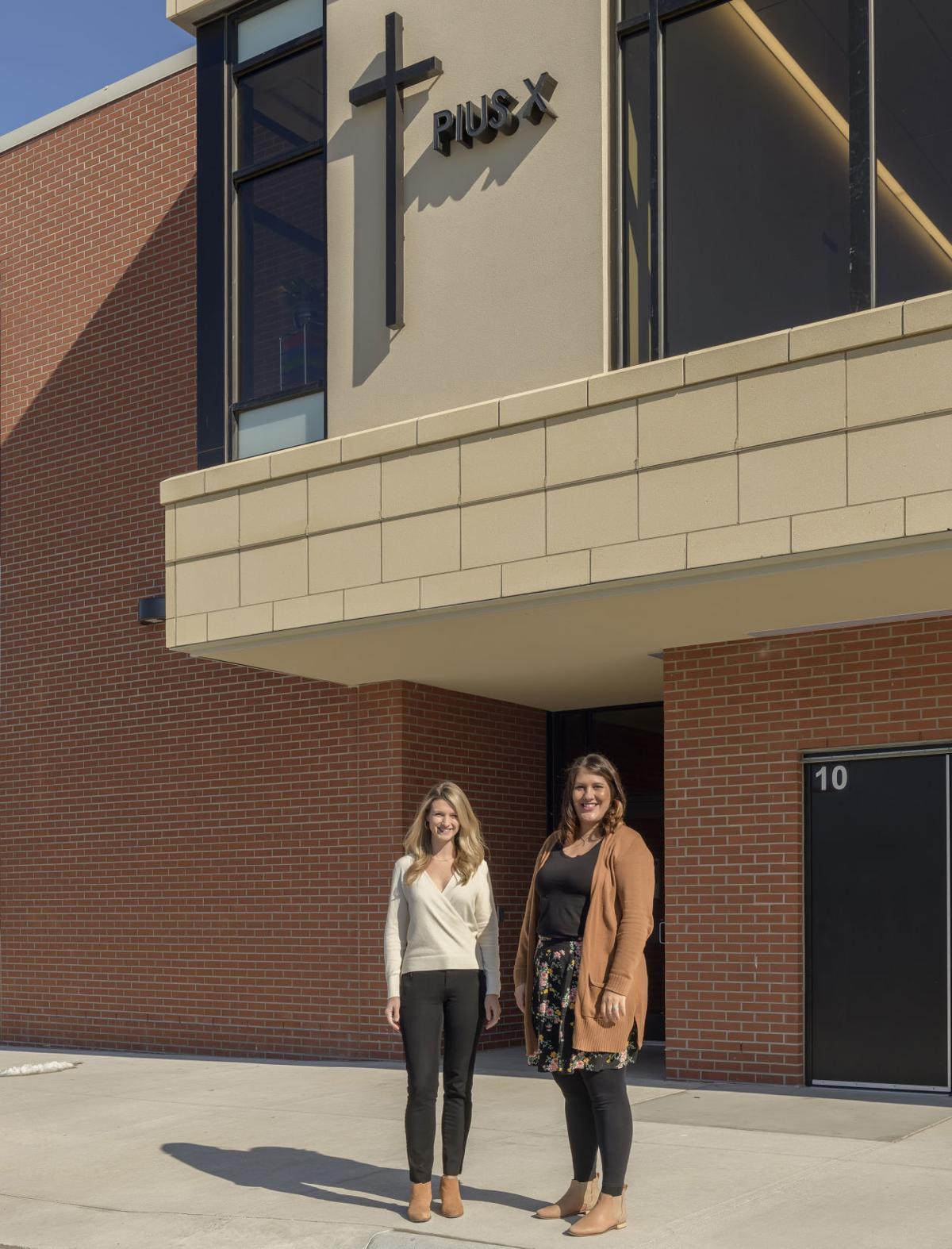 Kathryn Bergen, Courtney Johnson outside new addition