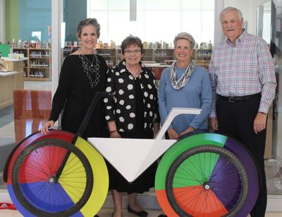 """Liz Shea-McCoy, Marilyn Moore, and Sue and Ed Tricker with the """"Color Wheel"""" bicycle"""