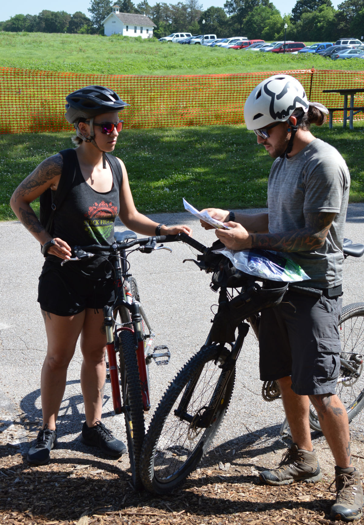 Domineque Hass and TJ Valderaz look over course map