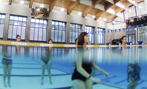 Nwu students learning music conducting in the pool education for Cochrane pool swimming lessons
