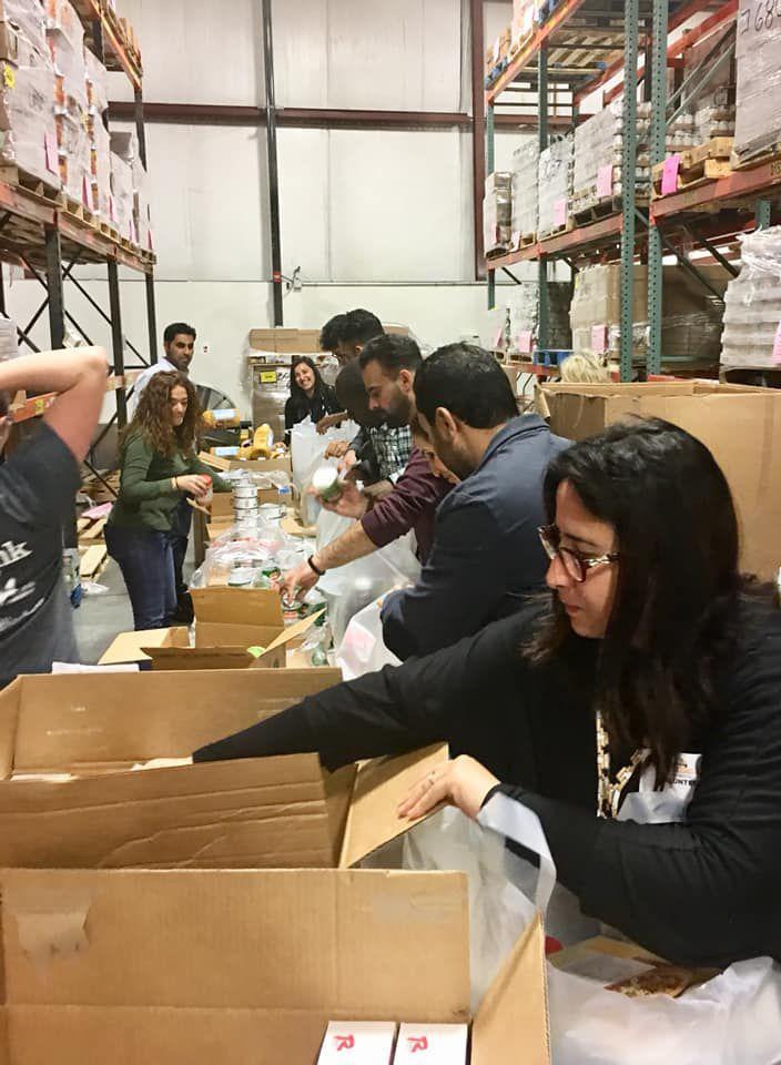 International visitors volunteer at Food Bank